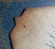 Photo-corner style against dark blue kraft-core card stock